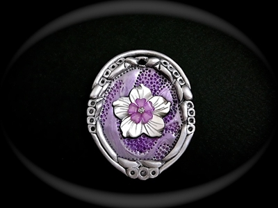 Picture of Polymer clay,Mother of Pearl and Cubic Zirconia.
