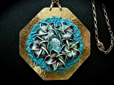 Picture of Brass pendant from polymer clay and glass.