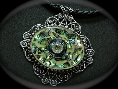 Picture of Abalone shell, Swarovski, glow in the dark pain, resin and antique silver brass.